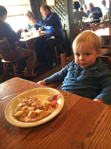 This was at Cracker Barrel after church Sunday morning.  Just chillin' in his booster seat.  This child.  Such a mess.