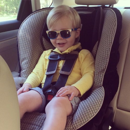 Somebody got his car seat turned around finally, and he's pretty excited about it.