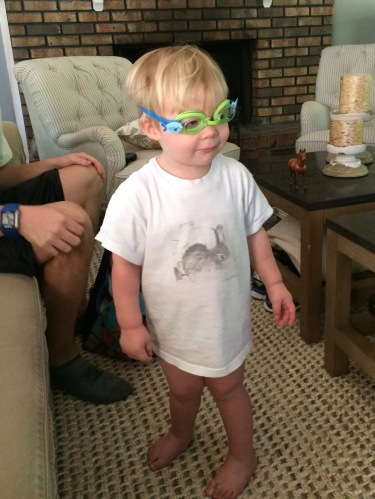 This kid.  He received some swim goggles as one of his birthday gifts, but he hasn't quite figured out that you don't wear them around the house