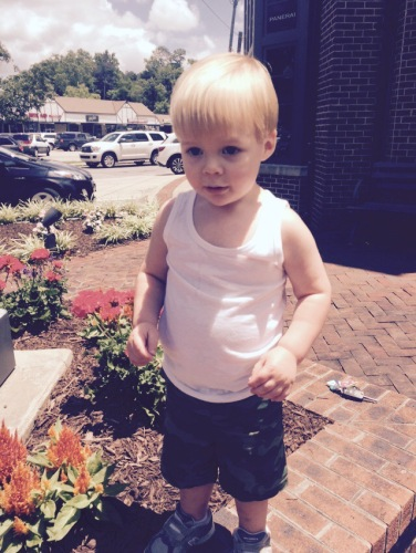 Asher Wade got a much needed haircut. And yes he's wearing a white tank top and camo shorts. It is Alabama y'all!